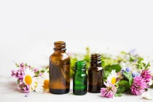 essential oil bottles with commonly used flowers