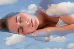 woman sleeping, with clouds floating around her