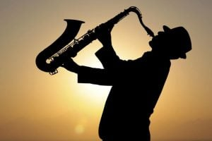 silhouette of man playing sax