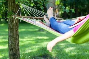 Young woman resting in hammock