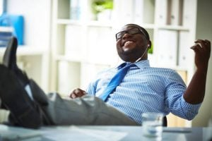 man listening to music at work | Unify Health