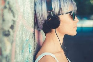 woman listening to music | Unify Health
