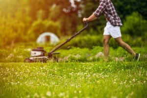 young man mowing lawn | Unify Health