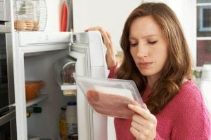 woman checking food | Unify Health
