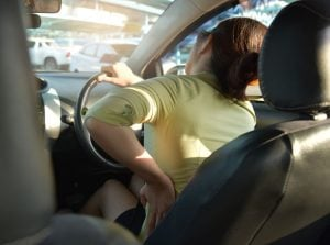woman driving with back pain | Unify Health