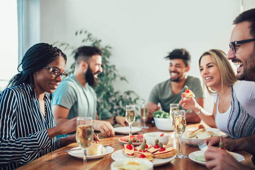 friends enjoying dinner | Unify Health